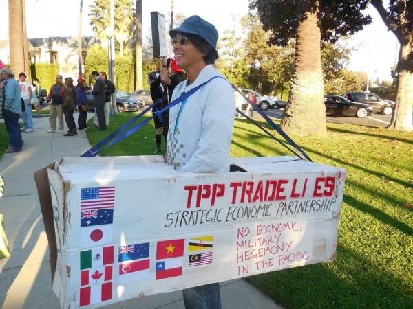 Arnie Saiki an expert on the TPP made a wearable sign.
