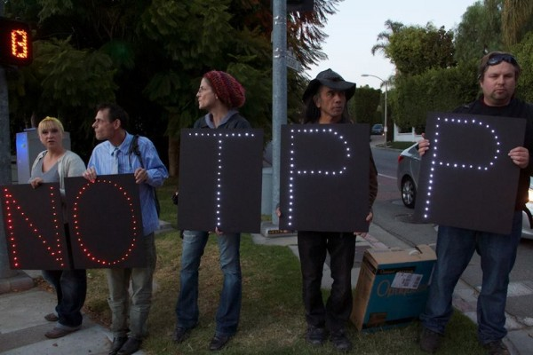 The Los Angeles Overpass Light Brigade, in position on Tower Road, the road leading to the fundraiser.