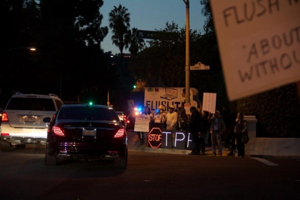 The San Diego Overpass Light Brigade came up to join the action. They stayed around the corner of Summit Dr. and Benedict Canyon in case the motorcade cut-off before Tower Road.