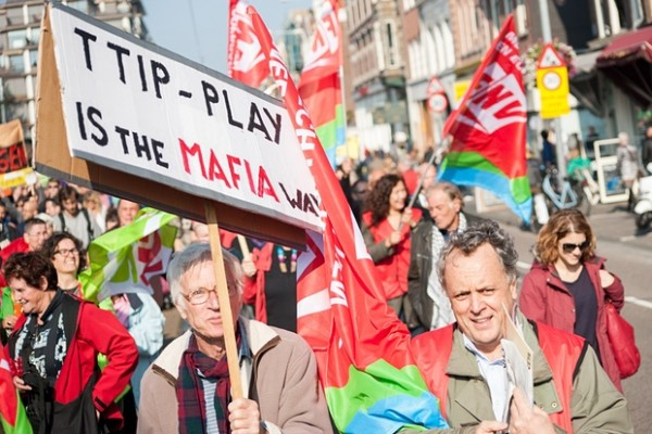 Banners reading 'TTIP play is the Mafia way' in a protest in Amsterdam, October 2015. Photograph: Lucia Lambriex/Getty Images