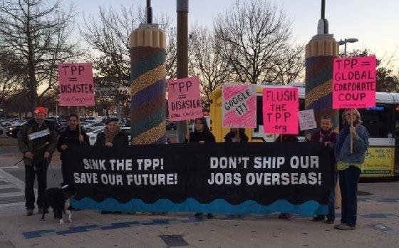 2016-2-4 FLUSH THE TPP MockingStation grp LH crop
